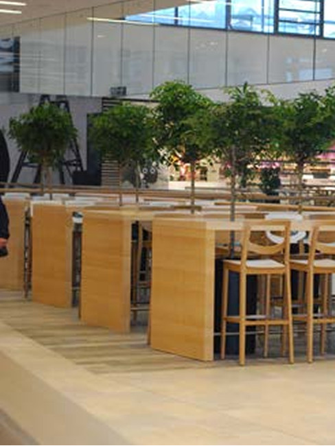 food court in a shopping centre with bar stools and high tables